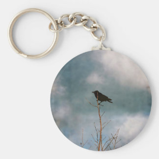 Vintage photograph of a crow on a tree keychain