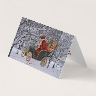 Vintage Santa Driving in a Modern Snow Scene Cards