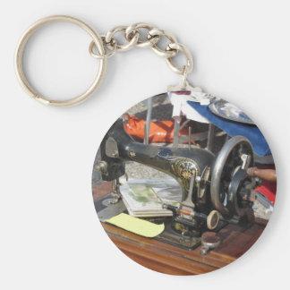 Vintage sewing machine at flea market basic round button keychain