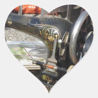 Vintage sewing machine at flea market heart sticker