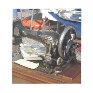 Vintage sewing machine at flea market notepad