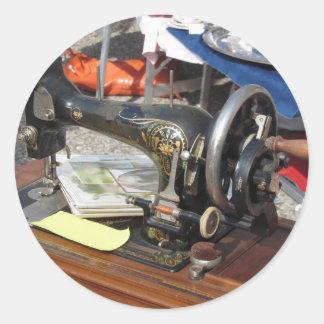 Vintage sewing machine at flea market round sticker