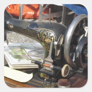 Vintage sewing machine at flea market square sticker
