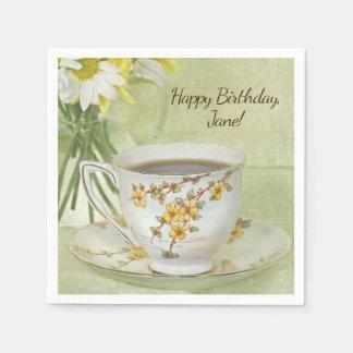 vintage teacup with daisy bouquet napkin