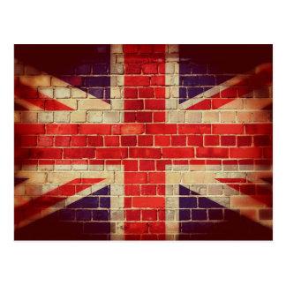 Vintage UK flag on a brick wall Postcard