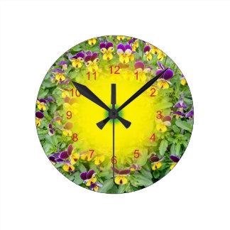 Viola flowers in a Spring Garden Round Clock
