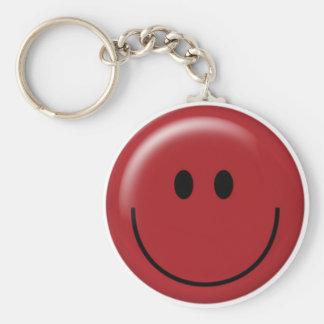 Visage souriant rouge heureux porte-clef