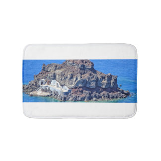 Volcanic rock in the sea in Santorin Greece Bath Mat