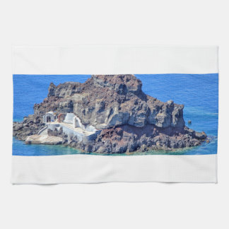 Volcanic rock in the sea in Santorin Greece Kitchen Towel