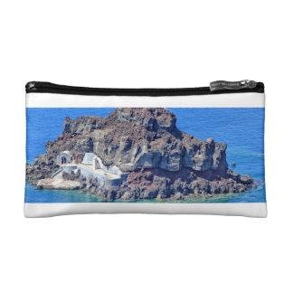 Volcanic rock in the sea in Santorin Greece Makeup Bag