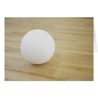 Volleyball on wooden floor card