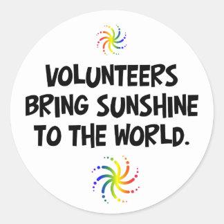 Volunteers bring sunshine to the world round sticker