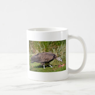 Vulture on grass coffee mug