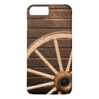 Wagon wheel leaning against old wooden wall iPhone 7 plus case