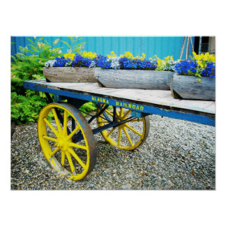 Wagon with yellow and blue flowers, Alaska Poster