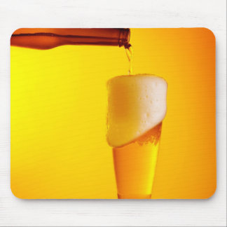 Waiter pouring beer, glass of a cold drink mouse pad