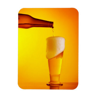 Waiter pouring beer, glass of a cold drink rectangular photo magnet