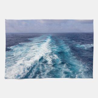 wake of a cruise ship towels