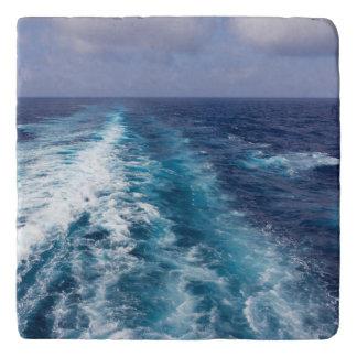 wake of a cruise ship trivet