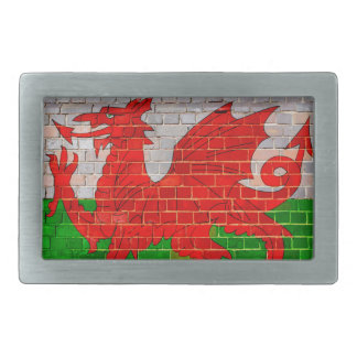 Wales flag on a brick wall belt buckle