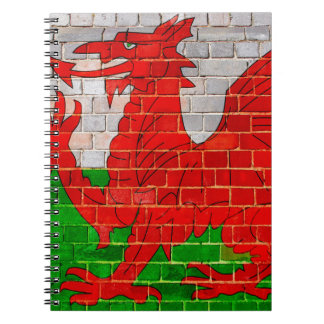 Wales flag on a brick wall notebooks