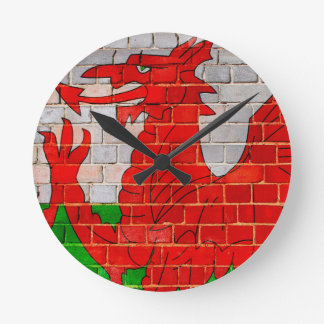 Wales flag on a brick wall round clock
