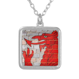 Wales flag on a brick wall silver plated necklace