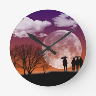 Walking in front of the moon Digital Art Round Clock