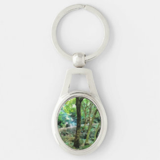 Walking through the forest Silver-Colored oval keychain
