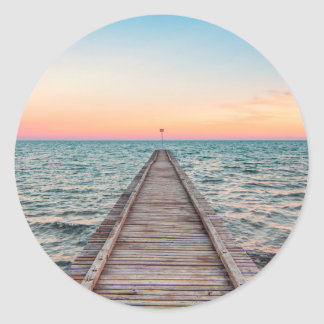 Walking towards the infinity of the sea classic round sticker