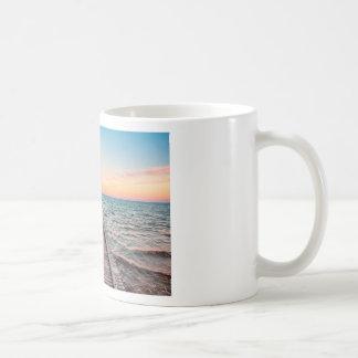 Walking towards the infinity of the sea coffee mug