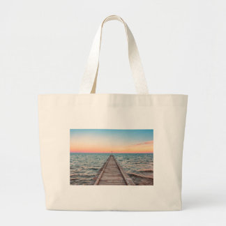 Walking towards the infinity of the sea large tote bag