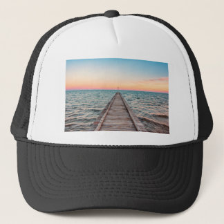 Walking towards the infinity of the sea trucker hat