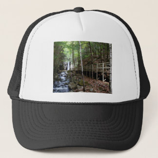 walkway near stream trucker hat