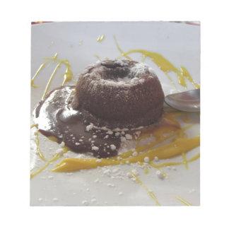Warm chocolate fondant lava cake dessert notepad