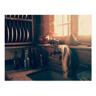 Warm light in a rustic kitchen postcard