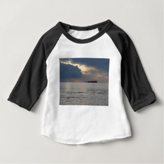 Warm sea sunset with cargo ship and a small boat baby T-Shirt
