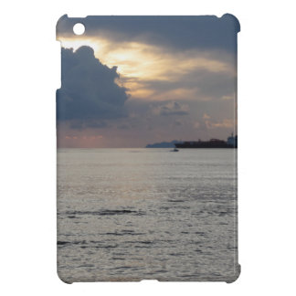 Warm sea sunset with cargo ship and a small boat iPad mini cover