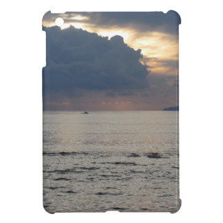 Warm sea sunset with cargo ship and a small boat iPad mini covers