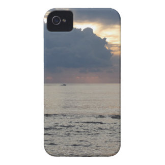 Warm sea sunset with cargo ship and a small boat iPhone 4 covers