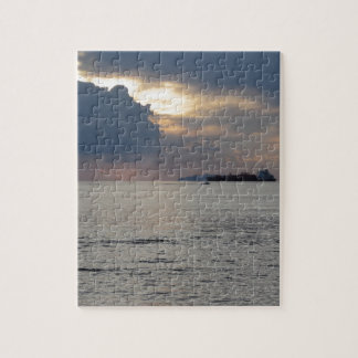 Warm sea sunset with cargo ship and a small boat jigsaw puzzle