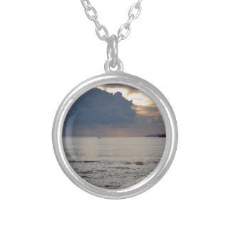 Warm sea sunset with cargo ship and a small boat silver plated necklace
