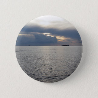 Warm sea sunset with cargo ship at the horizon 2 inch round button