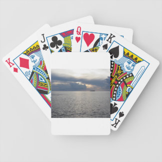 Warm sea sunset with cargo ship at the horizon bicycle playing cards