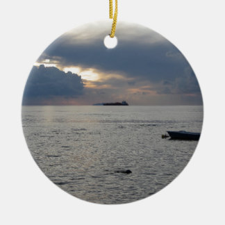 Warm sea sunset with cargo ship at the horizon ceramic ornament