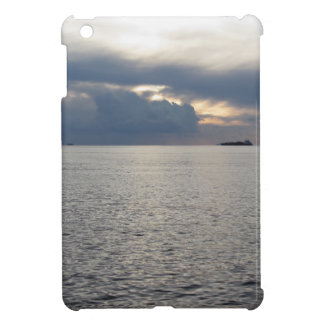 Warm sea sunset with cargo ship at the horizon iPad mini cover