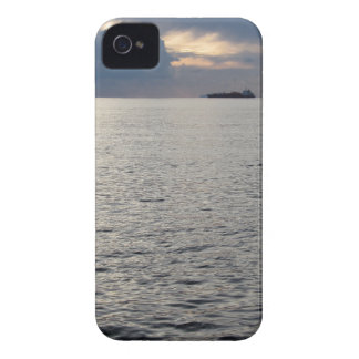 Warm sea sunset with cargo ship at the horizon iPhone 4 case