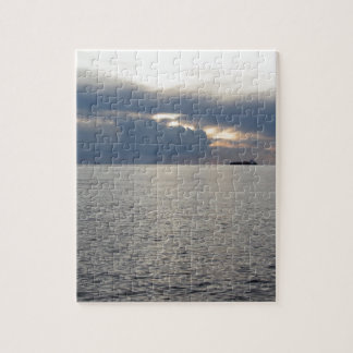 Warm sea sunset with cargo ship at the horizon jigsaw puzzle