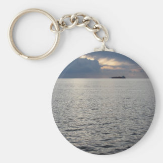 Warm sea sunset with cargo ship at the horizon keychain