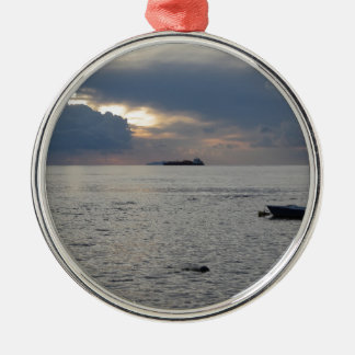 Warm sea sunset with cargo ship at the horizon metal ornament